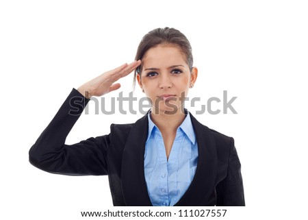 Portrait of an attractive young business woman saluting. Facing the camera, over white background
