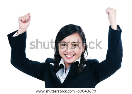 Portrait of an attractive young businesswoman with her arms raised, isolated on white.