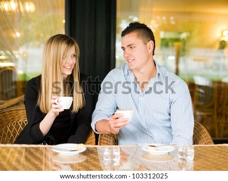 Portrait of an attractive young couple enjoying beverage.