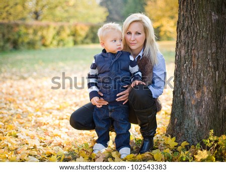 Portrait of an attractive young mother with her son in the park.