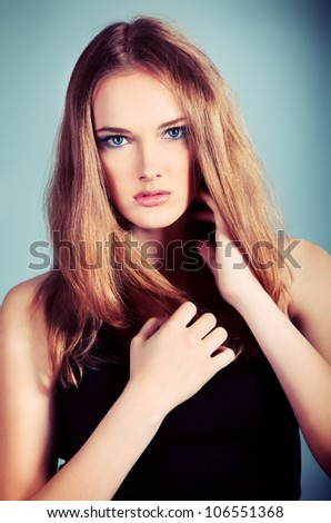 Portrait of an attractive young woman posing at studio. - stock photo