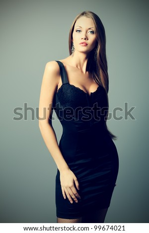 Portrait of an attractive young woman posing at studio.