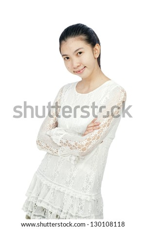 Portrait of an attractive young woman standing with her hand folded against white background
