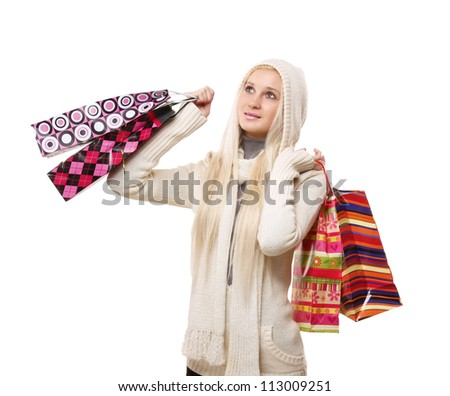 Portrait of an attractive young woman with shopping bags isolated on white background - stock photo