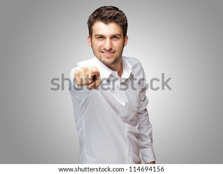 Portrait Of An Businessman Pointing Finger Isolated On Grey Background