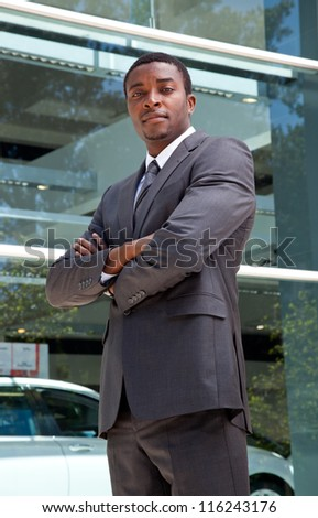 Portrait of an confident african business man crossing his arms