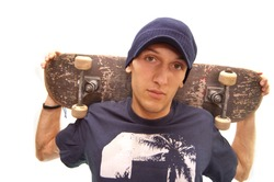portrait of an cool skater with his board