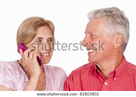 portrait of an elderly couple with phone - stock photo