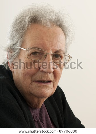 Portrait of an elderly lady, senior adult, pale background
