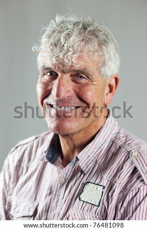 Portrait of an elderly man - stock photo