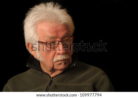 Portrait of an elderly man looking to the side