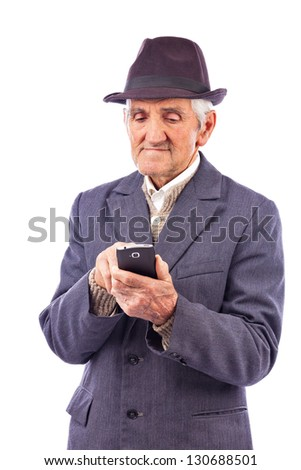 Portrait of an elderly man using mobil phone against white background