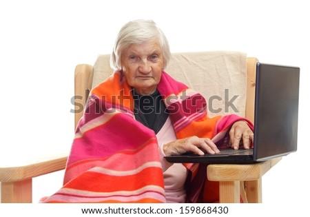 Portrait of an elderly using a notebook