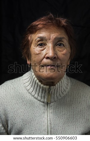 portrait of an elderly woman  #550906603