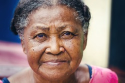 portrait of an elderly woman with beautiful look of Dominican Latin origin looking at the camera
