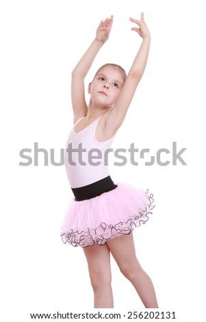 3ebd6465c43e Portrait of an elegant little ballerina in a pink tutu dancing ...