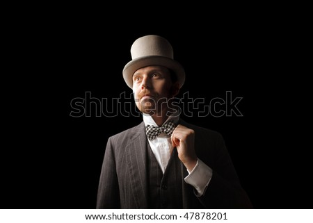 Portrait of an elegant man wearing a cylinder hat