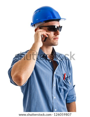 Portrait of an engineer talking at phone. Isolated on white