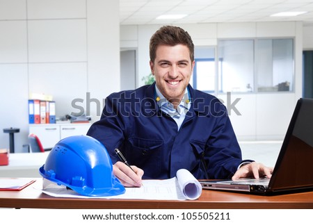 Portrait of an engineer using a notebook on his desk