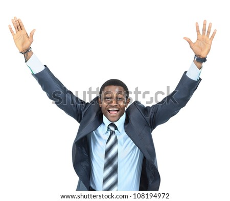 Portrait of an excited businessman with arms raised in success on white background