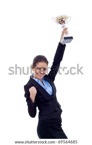 Portrait of an excited young business woman winning a trophy against white background