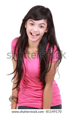 Portrait of an excited young lady laughing against white background