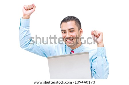 Portrait of an excited young man celebrating success