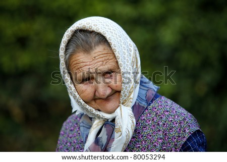 Portrait of an expressive old woman outdoor. - stock photo