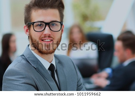 Portrait of an handsome businessman in front of his team. #1011959662
