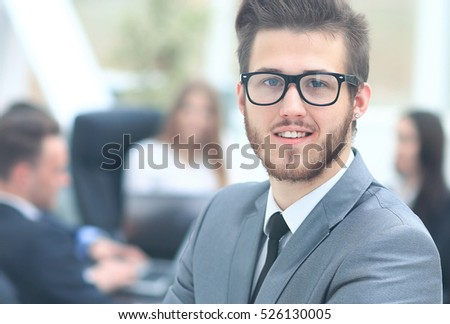 Portrait of an handsome businessman in front of his team #526130005