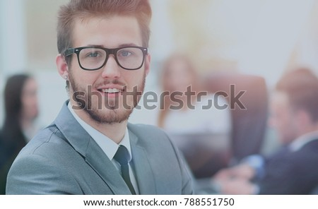 Portrait of an handsome businessman in front of his team #788551750
