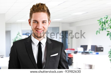 Portrait of an handsome businessman in his office