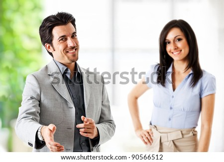 Portrait of an handsome businessman introducing himself - stock photo