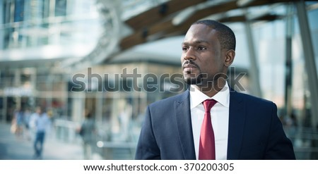 Portrait of an handsome businessman walking in a business environment