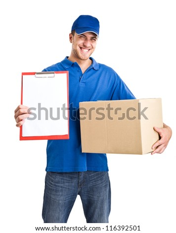 Portrait of an handsome deliverer holding a box. Isolated on white
