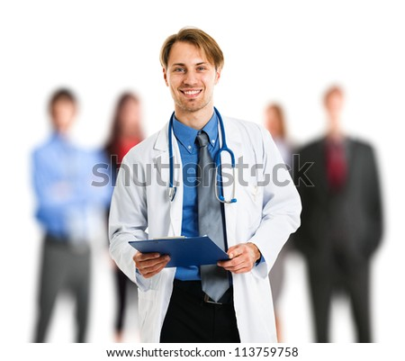 Portrait of an handsome doctor in front of his patients