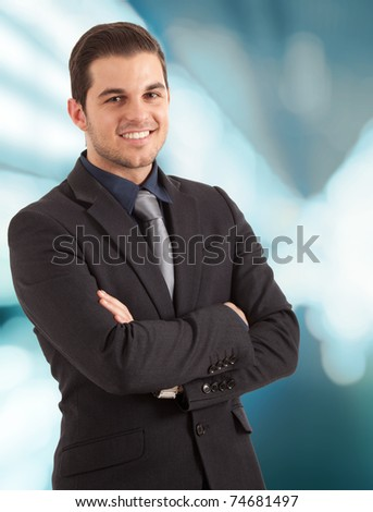 Portrait of an happy businessman. Blue blurred background.