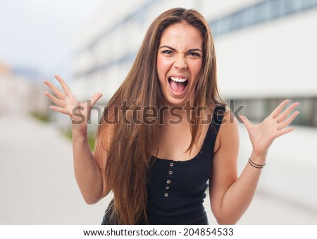 portrait of an hysterical girl shouting and gesturing