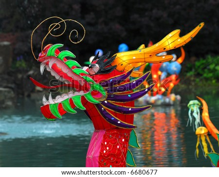 Portrait of an Illuminated Chinese Dragon on a lake