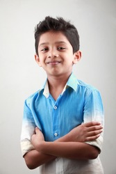 Portrait of an Indian boy with hands tied together