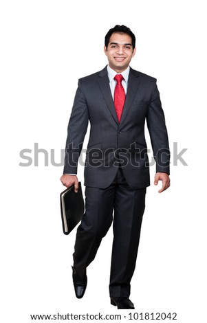 portrait of an Indian Businessman holding a book