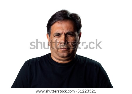 Portrait of an Indian man, isolated studio shot