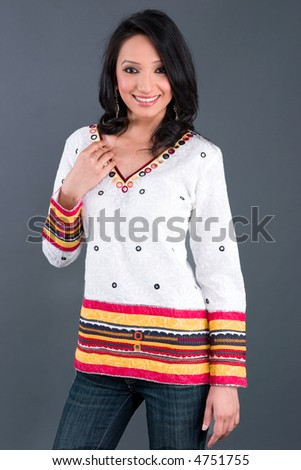 Portrait of an Indian woman wearing a tunic with traditional Indian embroidery