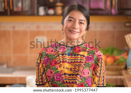 Portrait of an indigenous woman looking at camera smiling and happy. Photo stock ©