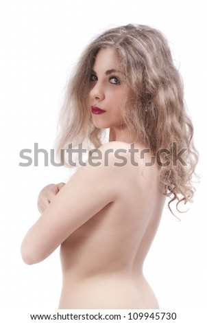 Portrait of an isolated young naked woman from back