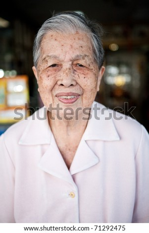 Portrait of an old Asian Chinese woman on home background