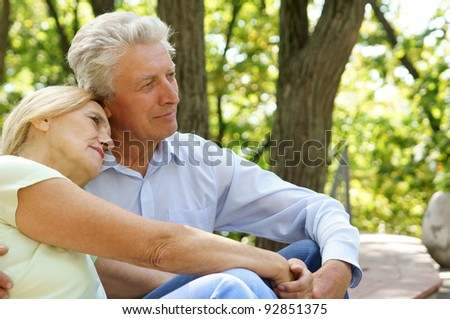 portrait of an old couple at park