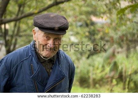Portrait of an Old walking in garden