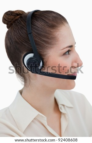 Portrait of an operator posing with a headset against a white background
