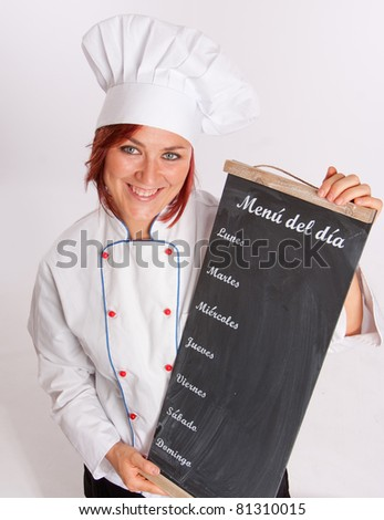 Portrait of an smiling professional female chef holding a menu slate